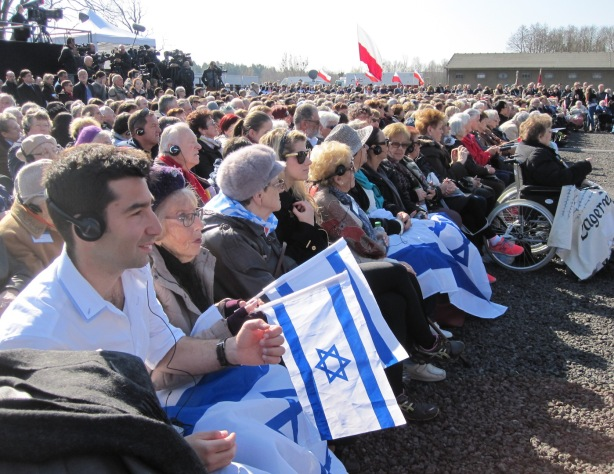 Part of the big delegation from Israel with Polish flags waving in the background