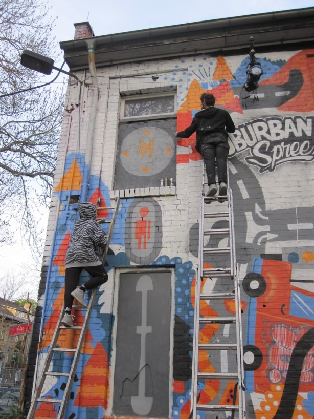 Street artists at work: Visiting graffiti artists from France reclaiming the space.