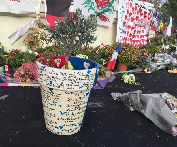 Names and ages of victims painted on a flowerpot.