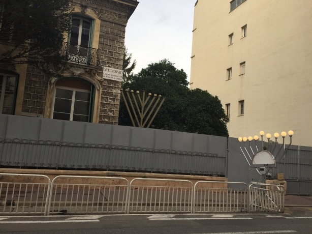 The Chanukah menorah surrounded by police barriers outside the Chabad movement building in central Nice, December 2016.